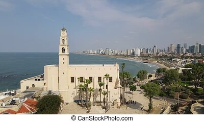 Aerial photo of Tel Aviv and Jaffa with the top of the bell tower from St Peters Church in Jaffa in the foreground. High quality 4k footage