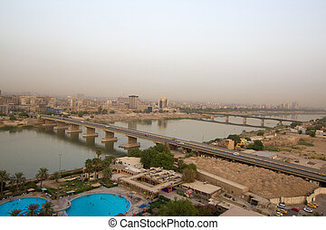 Aerial photo of the city of Baghdad, and shows where residential complexes and the Tigris River and bridges. The city of Baghdad, capital of Iraq.