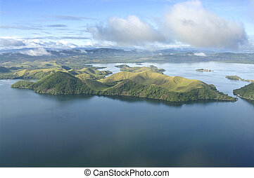 Aerial photo of the coast of New Guinea with jungles and...