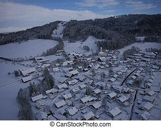 aerial photo of village in winter