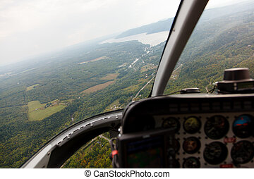 Aerial photography from a helicopter cockpit