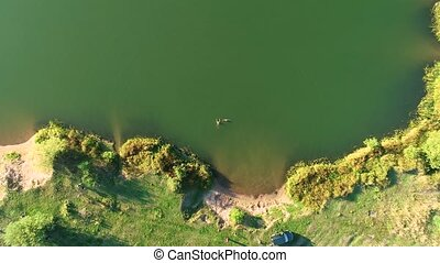 Aerial photography of a beautiful lake with green water.