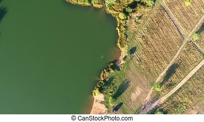Aerial photography of a large lake with green water.