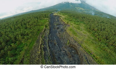 Aerial photography of volcanic outflowing river for ash....
