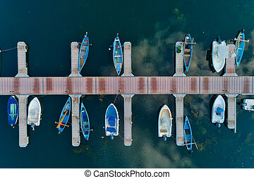 Aerial picture of floating dock with boats, motorboats and ...
