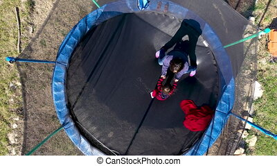 Aerial point of view of mother with her daughter having fun...