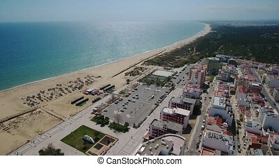 Aerial. Portuguese beaches and fishing boats in the tourist village Monte Gordo.
