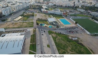 Aerial. Portuguese city of Faro from the air, highway and...