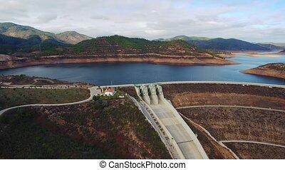 Aerial. Portuguese dam Odelouca, Monchique, filmed from the sky.