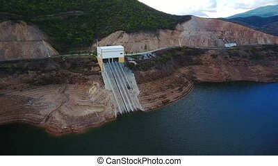 Aerial. Portuguese hydroelectro dam Odelouca, in mountains of Monchique. Algarve Portugal