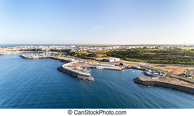 Aerial. Portuguese sea port Sinis with sailboats in regatta. Photographing from the drone.
