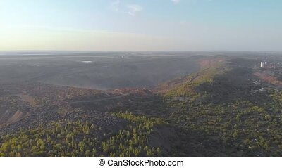 Aerial quarry sunset red iron ore aerial drone right side camera movement Krivoy Rog Ukraine