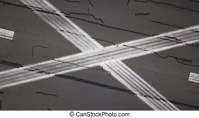Aerial recording of runway - Runway with white and pink road...