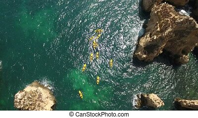 Aerial. Rise drone capture video kayaks in the bay Ponta de Piedade.