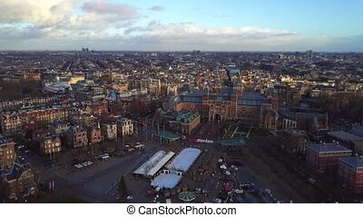 Aerial rising shot of Amsterdam cityscape, the Netherlands -...