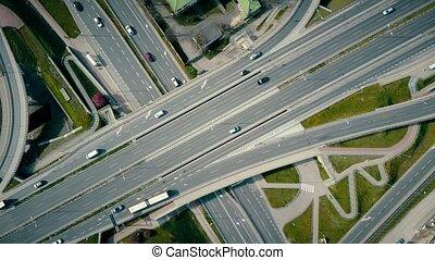 Aerial rising shot of big urban road junction, top down view. 4K video