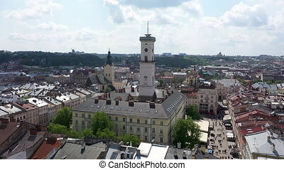 Aerial Roofs and streets Old City Lviv, Ukraine. Panorama of the ancient town. Town Hall, Ratush. Drone shot