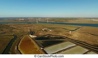 Aerial. Salt marshes view of the sky and river Guadiana....