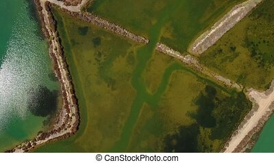 Aerial. Salty lakes close-up of village Fuseta. - Aerial....