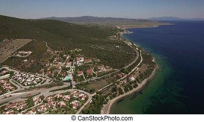 Aerial scene of sea, coastline and Trikorfo Beach with green...