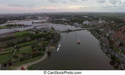 Aerial scene of town and river in Netherlands