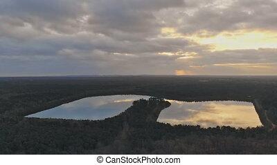 Aerial scenic view of lakes at sunrise landscape in a forest...