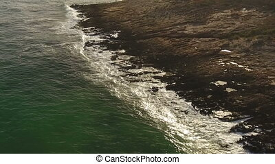Aerial. Sea waves filmed by from the sky in slow motion.