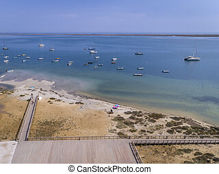 Aerial seascape, in Ria Formosa wetlands natural park, over...