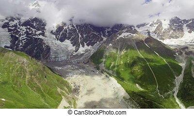 AERIAL: Shkhara Glacier in svaneti Rocks. Georgia.