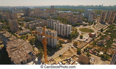 Aerial shoot of construction site with tower cranes. Drone footage