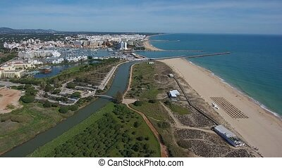 Aerial. Shooting a video from the sky with the drone of a tourist town Vilamoura. Algarve