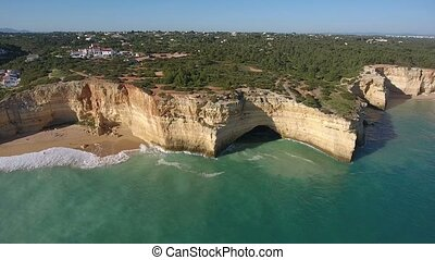 Aerial. Shooting a video from the sky with the drones of a Portuguese beach Benagil. Algarve