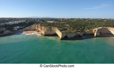Aerial. Shooting a video from the sky with the drones of a Portuguese beach Benagil. Portugal