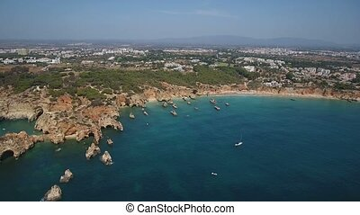 Aerial. Shooting from sky of the beaches of Portimao in summer, magnificent rocks. Algarve Portugal.