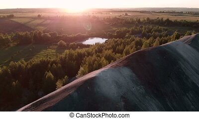 Aerial shooting over the mountain at sunset time. Flight. 4k...