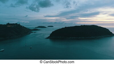 Aerial shot at Laem Phrom Thep watch sunset in Phuket,...