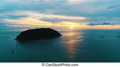 Aerial shot at Laem Phrom Thep watch sunset in Phuket,...