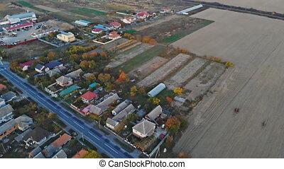 Aerial shot beautiful small village near green field in the autumn