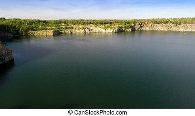 Flying Over Quarry Lake - Aerial shot: Flying Over Quarry...