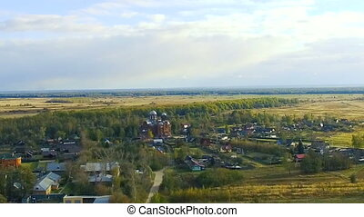 Aerial shot, flying over Russia towards church