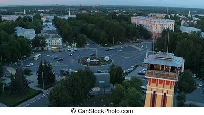 Aerial shot movement of cars in the city evening