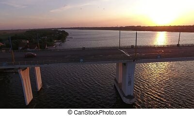 Aerial shot of a big bridge at pink sunset from a drone...