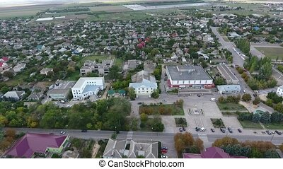 Gorgeous bird`s eye view of a large city in the south of Ukraine with big administrative buildings, comfortable private houses and greenery