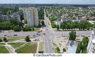 Aerial shot of a busy and wide crossroads in Kherson in...
