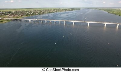 Aerial shot of a car bridge over the Dnipro river in Ukraine in a sunny day