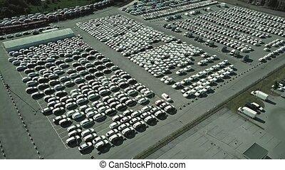 Aerial shot of a car manufacturer parking