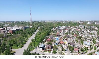 Aerial shot of a cityscape in Kherson with numerous summer cottages and TV tower