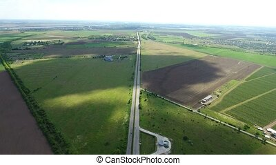 Aerial shot of a countryside highway in Kherson region in a...