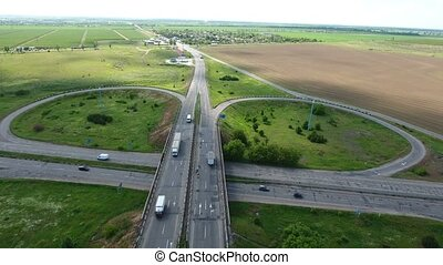 Aerial shot of a countryside intersection in Eastern Europe in a sunny day