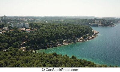 Aerial shot of a Croatian beach resort in Pula on the Adriatic sea. Summer vacation time